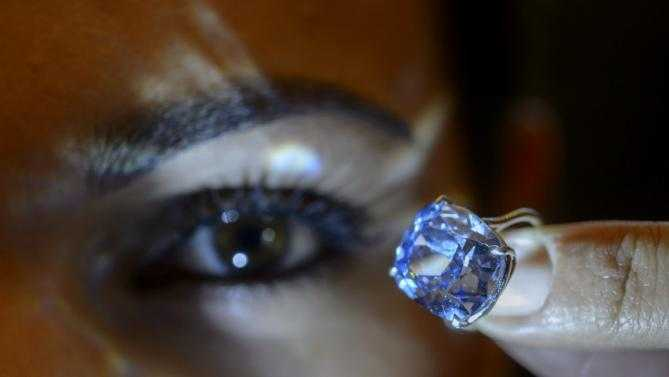 Sotheby's: Hong Kong Billionaire Pays Record $48 Million for 12.03-Carat Blue Moon Diamond