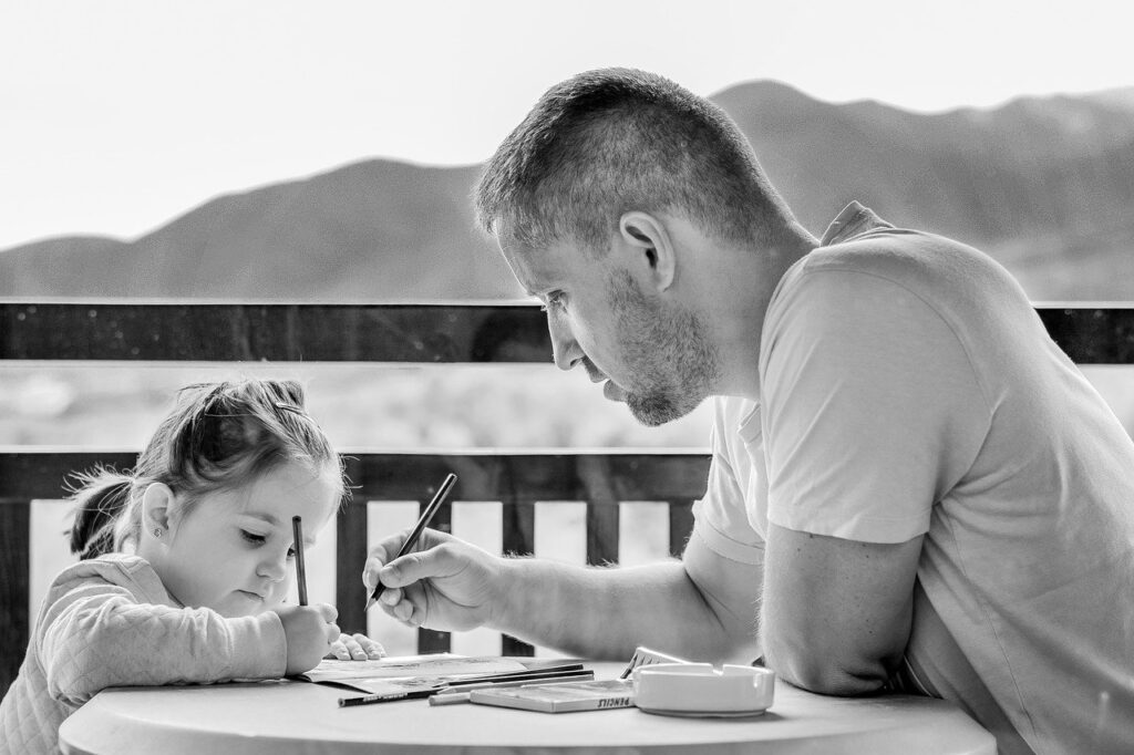 Father doing homework with daughter